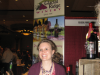 Jenna from Spicer, Minnesota pours at the Glacial Ridge Winery booth