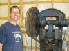 Joe Hoffmeister with a functional cooperage machine from the early 1900\'s