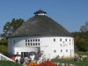 Round Barn\'s main tasting room is an Amish barn that was built in Rochester Indiana in 1911 and moved piece-by-piece to its current location in 1997.