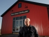 Gene Sigel stands in front of his Red Eagle Distillery, his latest business venture that was based upon a hunch on how the industry is evolving.