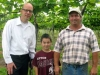 Midwest Wine Press Publisher, Mark Ganchiff and Two Oaks Vineyard owner John Harp with his grandson, William in front of Norton vines in April, 2012.